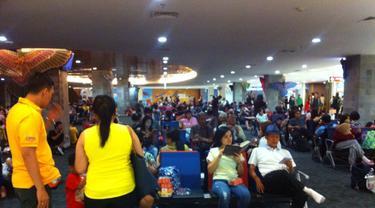 Penumpang di Bandara I Gusti Ngurah Rai. (Liputan6.com/Raya Herawati)