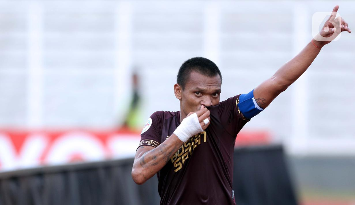 Pemain depan PSM Makassar, Ferdinand Sinaga merayakan gol yang dicetaknya ke gawang Shan United FC pada laga lanjutan Grup H Piala AFC 2020 di Stadion Madya Gelora Bung Karno, Jakarta, Rabu (26/2/2020). PSM Makassar unggul 3-1. (Liputan6.com/Helmi Fithriansyah)