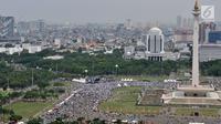 Umat muslim mengikuti aksi reuni 212 di Lapangan Monas, Jakarta, Minggu (2/12). Penyelenggaraan reuni ini merupakan kali kedua setelah juga dilakukan pada 2017. (Merdeka.com/Iqbal S. Nugroho)