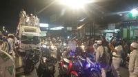 FPI tetap menggelar takbir keliling walau Polda Metro Jaya mengimbau hal itu tidak dilakukan. (Liputan6.com/Nafiysul Qodar)