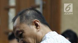 Mantan Kepala BPPN, Syafruddin Arsyad Temenggung saat menjalani sidang perdana di Pengadilan Tipikor Jakarta, Senin (14/5). Agenda sidang perdana merupakan pembacaan surat dakwaan oleh jaksa KPK. (Liputan6.com/Helmi Fithriansyah)