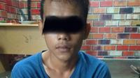 Seorang pemuda di Gorontalo berhasil ditangkap polisi lantaran menyebar kabar bohong alias hoaks yang meresahkan warga. (Liputan6.com/ Arfandi Ibrahim)