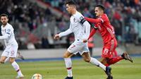 Aksi Cristiano Ronaldo ketika membela Portugal menghadapi Luksemburg. (AFP/John Thys)