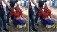 Lelaki Banglades yang mencari uang dengan sebagai objek foto memakai kostum Spiderman di Melaka (Sumber: worldoffbuzz)