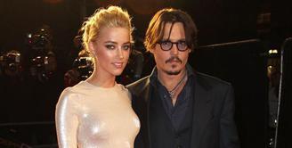 Bercerai dengan Johnny Depp, Amber Heard berniat mendonasikan hasil harta gono-gininya untuk orang-orang yang membutuhkan. Namun sampai saat ini tersiar kabar Amber belum juga menyerahkan hartanya. (doc.mirror.co.uk)