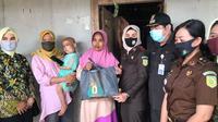 Nurasyifah balita 3 tahun di Bekasi yang mengidap tumor. (Liputan6.com/Bam Sinulingga)