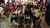 Wajib pajak antusias mengikuti pelaksanaan program tax amnesty di kantor pusat Ditjen Pajak, Jakarta, Minggu (25/9). Mengantisipasi lonjakan pendaftar, DJP membuka tempat pendaftaran program pada Sabtu-Minggu pukul 08.00-14.00. (Liputan6.com/Fery Pradolo)