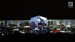 Salah satu pertunjukan projection mapping yang menggambarkan kondisi kota Jakarta di Museum Fatahillah, Jumat (19/1). Pertunjukan ini menandai rangkaian kegiatan perayaan 60 tahun hubungan diplomatik Indonesia-Jepang. (Liputan6.com/Helmi Fithriansyah)