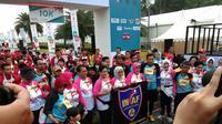 Ibu Negara Iriana Jokowi bersama Istri Wakil Presiden Mufida Kalla dan Ketua Yayasan Kemala Bhayangkari (YKB) yang juga istri Kapolri Tri Tito Karnavian membuka 'Kartini Run 2018'. (Merdeka.com/Ronald)