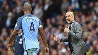 Vincent Kompany Optimistis dengan kualitas yang dimiliki Pep Guardiola. (AFP/Anthony Devlin)