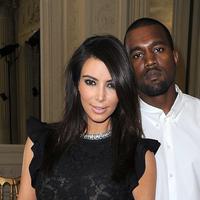 Kim Kardashian dan Kanye West (via businessinsider.com)