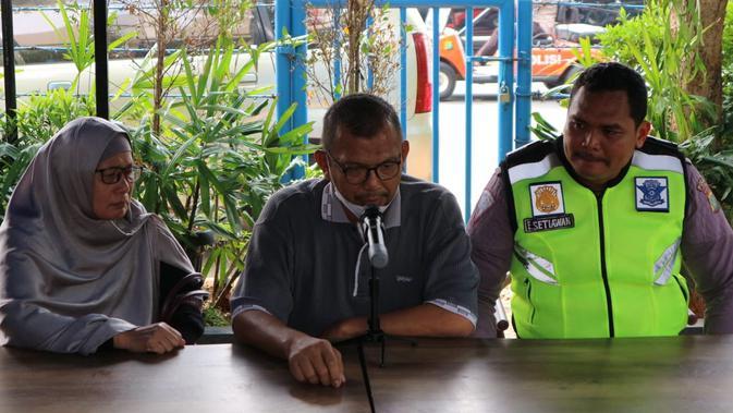 Bripka Eka Setiawan, polisi yang nyangkut di kap mobil di Pasar Minggu berdamai dengan pengemudi yang menabraknya. (Nur Habibie?Merdeka.com)