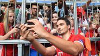 4. Mats Hummels, mantan kapten Dortmud ini sudah lama dikabarkan akan pindah ke Liga Inggris. Tapi hal tersebut tak kunjung terealisasi, sang pemain ternyata malah memilih Bayern Munchen sebagai pelabuhan kariernya. (AFP/Christof Stache)