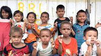 Gara-gara tingkat kemahalan yang melebihi Jawa, warga Puncak Jaya yang tak pernah ke kota baru mengenal adanya uang besi. (Liputan6.com/Katharina Janur)