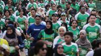 Ribuan peserta mengikuti lomba lari Milo Jakarta International 10K di kawasan Rasuna Epicentrum, Jakarta, Minggu (14/7/2019). Milo Jakarta International 10K diikuti oleh sekitar 16 ribu peserta. (Liputan6.com/Faizal Fanani)