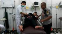 Anggota Polsek Bontoala Makassar terkena serpihan molotov (Liputan6.com/ Eka hakim)