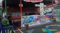 TPS bertema Asian Games di Kecamatan Bukit Kecil Palembang (Lipiutan6.com / Nefri Inge)