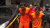 Polisi tangkap pembunuh sopir taksi online di Bogor. (Liputan6.com/Achmad Sudarno)