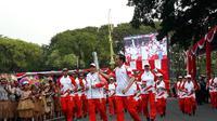 Presiden Jokowi membawa obor Asian Games 2018. (Merdeka.com)