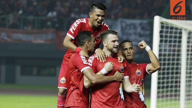 Striker Persija Jakarta, Marko Simic, melakukan selebrasi usai membobol gawang Selangor FA.(Bola.com/M Iqbal Ichsan)