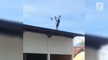 Seorang pemuda coba bunuh diri dengan memegang kabel tiang listrik di Pinrang, Sulawesi Selatan.