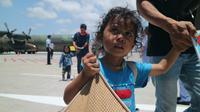 Pengungsi Wamena tiba di Bali. (Liputan6.com/Dewi Divianta)