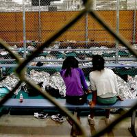Children at U.S. Customs and Border Protection facility in 2014, image: Getty