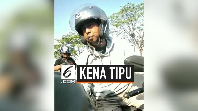Sepasang suami istri kena tipu oleh 2 pengendara motor karena takut kena razia penilangan oleh Polisi. Mereka pun membayar uang jaminan ke 2 pengendara motor tersebut untuk mengawal agar tidak kena tilang.