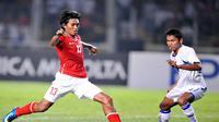 Aksi Budi Sudarsono ketika melawan Myanmar (ADEK BERRY / AFP)