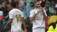 Karim Benzema dan Casemiro menjadi pahlawan kemenangan Real Madrid saat menghadapi Levante. (AFP/Curto de la Torre)