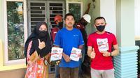 Pelanggan PLN Riau yang menikmati tambah daya listrik murah di Pekanbaru. (Liputan6.com/M Syukur)