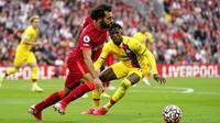 Mohamed Salah. Sumbangsih satu gol dan satu assistnya dalam kemenangan 3-0 Liverpool atas Crystal Palace membawa Liverpool untuk sementara berbagi puncak klasemen Liga Inggris bersama Chelsea dengan 13 poin dan selisih gol yang identik, surplus 11 gol. (AP/Jon Super)