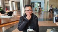 Direktur Eksekutif Amnesty International Indonesia Usman Hamid menyambangi Gedung Promoter Polda Metro Jaya, Selasa (9/7/2019). (Merdeka.com/ Ronald)