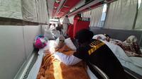 Jemaah haji di posko Kesehatan Haji di Arafah ( Foto: Baharuddin/MCH)