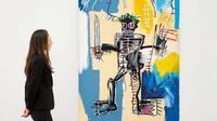 Lukisan Warrior karya Jean-Michel Basquiat. (dok. Instagram @christiesinc/ https://www.instagram.com/p/CLMk9Ktnki2/?igshid=1y0uzqswc9zxu / Melia Setiawati)