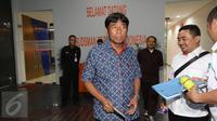 Anggota DPRD DKI Jakarta Abraham Lunggana (Haji Lulung) usai diperiksa penyidik Direktorat Tindak Pidana Korupsi Bareskrim Polri di Ombudsman, Jakarta, Rabu (12/4). (Liputan6.com/Helmi Afandi)
