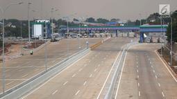 Gerbang Tol Cilandak Utama yang menghubungkan Depok-Antasari di kawasan Cilandak Timur, Jakarta, Minggu (23/9). Tol tersebut nantinya akan menjadi ruas tol penghubung Jalan Lingkar Luar Jakarta (JORR) dengan JORR II. (Liputan6.com/Immanuel Antonius)