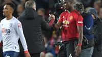Paul Pogba mengaku menikmati permainannya Manchester United di bawah kendali Ole Gunnar Solskjaer. (AFP/Paul Ellis)