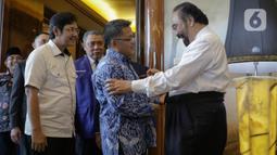 Ketum Partai Nasdem Surya Paloh terima kunjungan Presiden PKS Sohibul Iman bersama jajaran di DPP Nasdem, Jakarta, Rabu (29/1/2020). Sohibul mengatakan, kunjungan kali ini sebagai bentuk kunjungan balasan yang pernah dilakukan Paloh dan jajaran Nasdem akhir Oktober 2019. (Liputan6.com/Faizal Fanani)