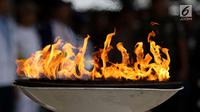 Api obor Asian Games tiba di Banda Aceh, Selasa (31/7). Sebelumnya, obor Asian Games tersebut diterbangkan dari Banjarmasin dan tiba di Lanud Sultan Iskandar Muda, Blang Bintang, Aceh Besar. (Liputan6.com/Immanuel Antonius)
