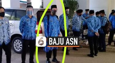 Viral foto pegawai PNS pria memakai baju Korpri mirip gamis. Menurut peraturan Permendagri nomor 11 tahun 2020 tentang pakaian dinas ASN model baju pegawai ini tidak sesuai aturan.