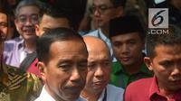 Presiden Joko Widodo usai mendaftarkan Capres-Cawapres ke Komisi Pemilihan Umum (KPU), Jakarta, Jumat (10/8).  Jokowi dan Ma'ruf Amin resmi sebagai capres-cawapres untuk Pilpres 2019. (Merdeka.com/Imam Buhori)