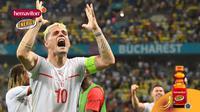 Hemaviton - Ekspresi kapten Swiss, Granit Xhaka, saat mengalahkan Prancis (Bola.com/Adreanus Titus/Foto: JUSTIN SETTERFIELD/AFP)