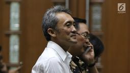Tersangka suap pengajuan PK ke PN Jakarta Pusat, Eddy Sindoro bersiap menjalani sidang di Pengadilan Tipikor, Jakarta, Kamis (27/12). Pemberian suap terkait pengurusan dua perkara di Pengadilan Negeri Jakarta Pusat.(Liputan6.com/Helmi Fithriansyah)