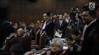 Ketua Tim Hukum Joko Widodo-Ma'ruf Amin, Yusril Ihza Mahendra saat tiba untuk mengikuti sidang sengketa Pilpres 2019 di Gedung MK, Jakarta, Selasa (18/6/2019). Sidang beragendakan mendengarkan jawaban dari termohon. (Liputan6.com/Faizal Fanani)