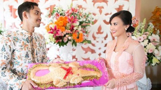 Makna Filosofis Roti Buaya Dalam Pernikahan Adat Betawi