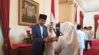 Presiden Jokowi saat open house di Istana Jakarta, Rabu (5/6/2019). (Merdeka.com/Intan Umbari Prihatin)