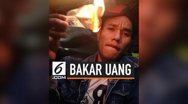 Viral seorang pria membakar uang secara live di Facebook. Sontak aksinya tersebut mengundang perhatian warganet.