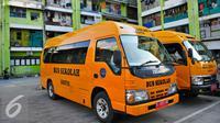 Fasilitas bus sekolah gratis kini telah ada di Rusun Muara Kapuk, Jakarta, Jumat (22/4/2016). Sebanyak 2 unit mobil akan beroperasi setiap hari untuk memudahkan anak sekolah yang tinggal di Rusun Muara Kapuk. (Liputan6.com/Yoppy Renato)