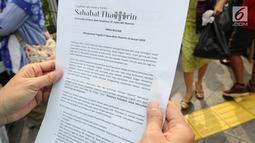Pernyataan sikap komunitas Sahabat Thamrin saat mengenang tragedi 3 tahun bom Thamrin di kawasan Thamrin, Jakarta, Minggu (13/1). Acara ini bertema 'Menerima Perbedaan untuk Merayakan Kebersamaan dan Perdamaian'. (Liputan6.com/Herman Zakharia)